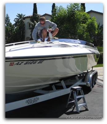 applying boat cleaner wax