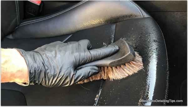 cleaning black coated car leather