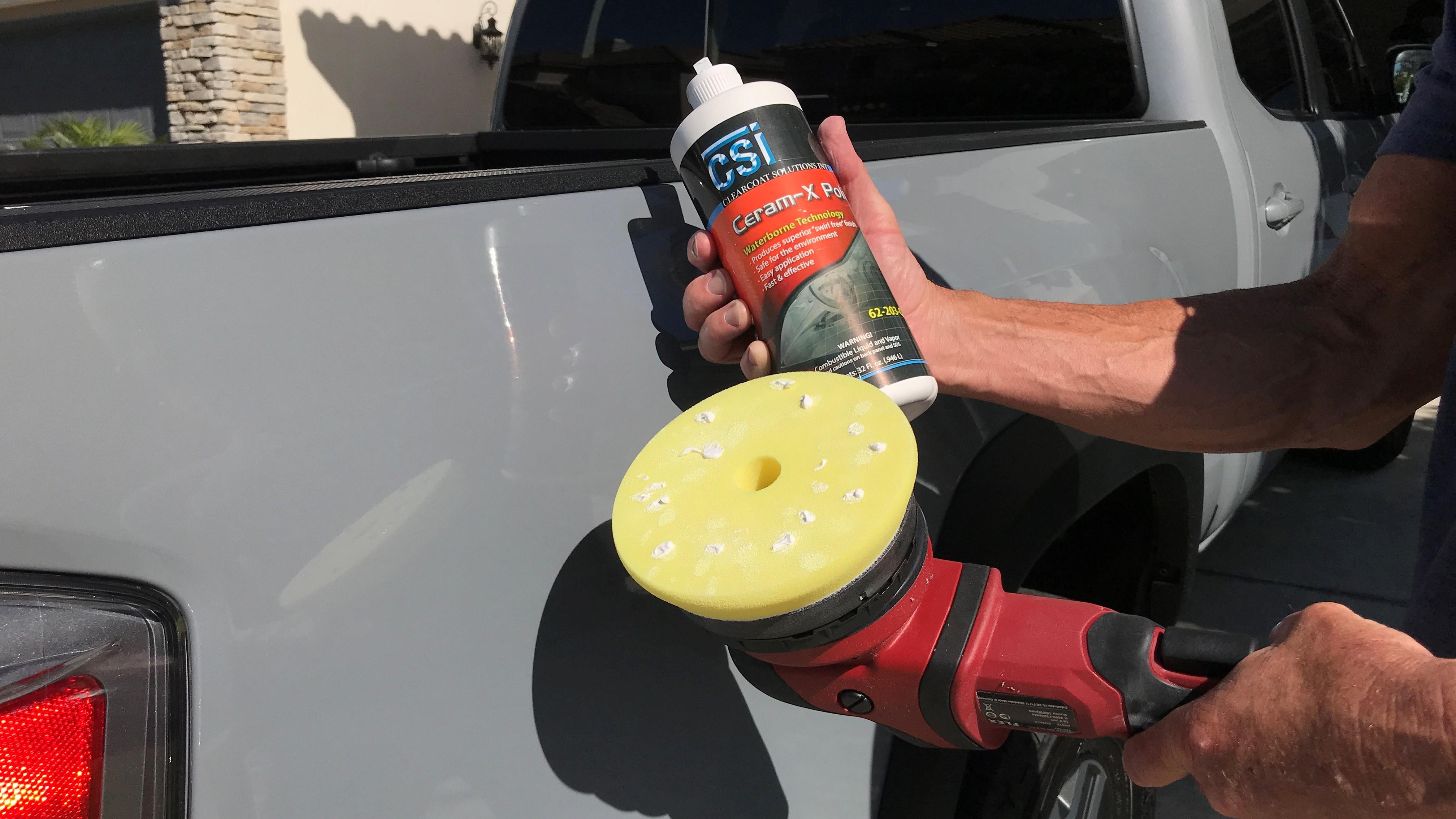 polishing a car with buffer