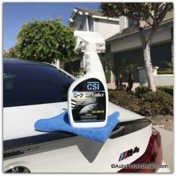 using quick detailer to clean car windows