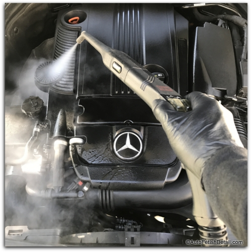 steam cleaning car engine