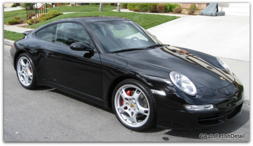 waxing a black car porsche