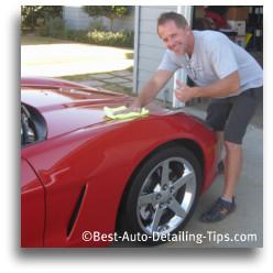 darren using black magic car wax