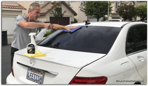 cleaning car windows with q-7 detailer