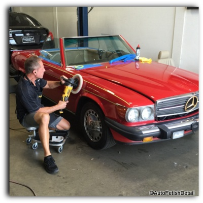 polishing a car with a rotary polisher