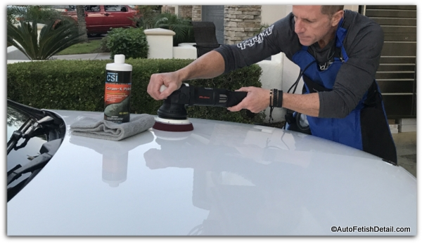 polishing car after removing paint overspray on car