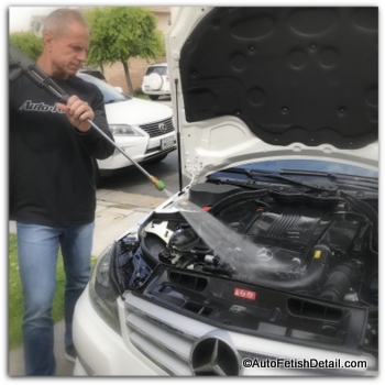 pressure washer to clean and detail car engine