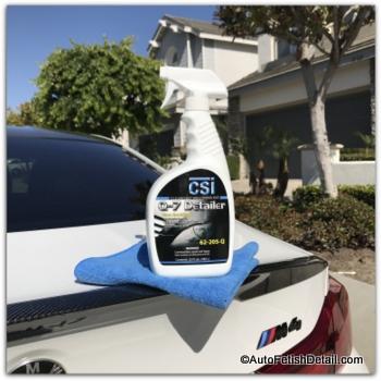 using quick detailer to clean car windows