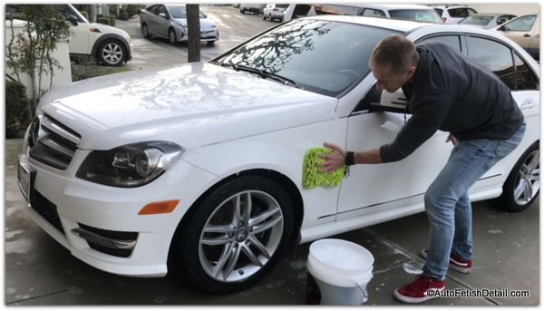 washing car with car wash soap